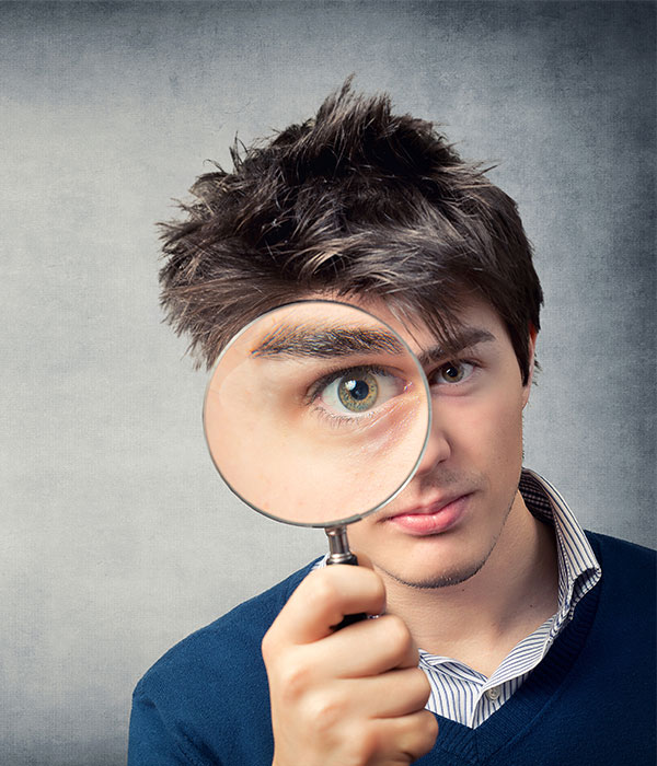 Man using a magnifying glass